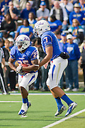 Dec 1, 2012; Tulsa, Ok, USA; Tulsa Hurricanes quarterback Cody Green (7) hands the ball to tailback Ja'Terian Douglas (25) during a game against the University of Central Florida Knights at Skelly Field at H.A. Chapman Stadium. Tulsa defeated UCF 33-27 in overtime to win the CUSA Championship. Mandatory Credit: Beth Hall-USA TODAY Sports