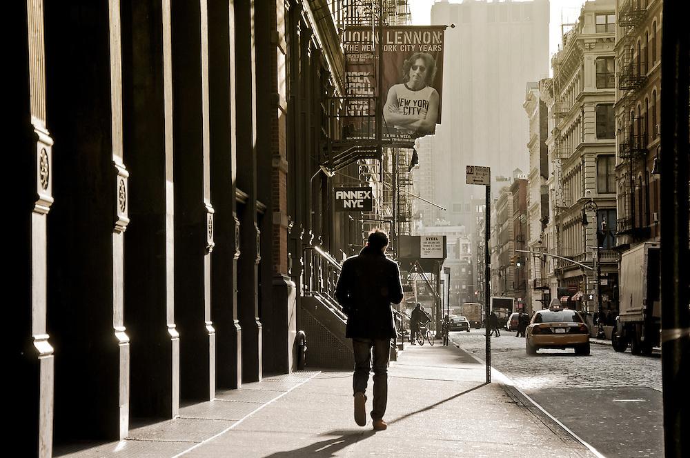 A guy walks on a street of SoHo, Manhattan, New York.