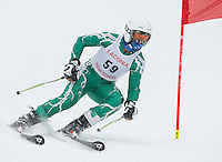 Laconia's Griffen Nyhan charges the giant slalom course during the Division III alpine race at Gunstock on Friday morning.  (Karen Bobotas/for the Laconia Daily Sun)