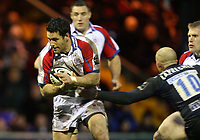 Photo: Rich Eaton.<br /> <br /> Sale Sharks v Bristol Rugby. Guinness Premiership. 01/01/2007. David Hill left of Bristol evades Daniel Larrechea the Sale stand  off