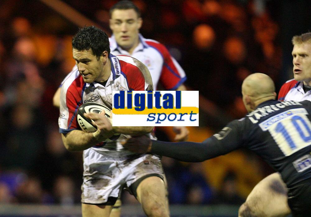 Photo: Rich Eaton.<br /> <br /> Sale Sharks v Bristol Rugby. Guinness Premiership. 01/01/2007. David Hill left of Bristol evades Daniel Larrechea the Sale stand  off
