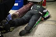 January 30-31, 2016: Daytona 24 hour: A mechanic sleeps during the Daytona 24