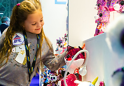 Freya, 7, looks at the exhibits at Ty toys stand at the Toy Fair at Kensington Olympia in London, the UK's largest dedicated game and hobby exhibition featuring the hottest and most anticipated products for the year ahead. London, January 22 2019.