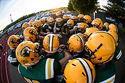 BFA St. Albans huddles together before the start of the football game between the Mount Mansfield Cougars and the BFA St. Albans Bobwhites at BFA High School on Friday night September 7, 2018 in St. Albans. (BRIAN JENKINS/for the FRESS PRESS)