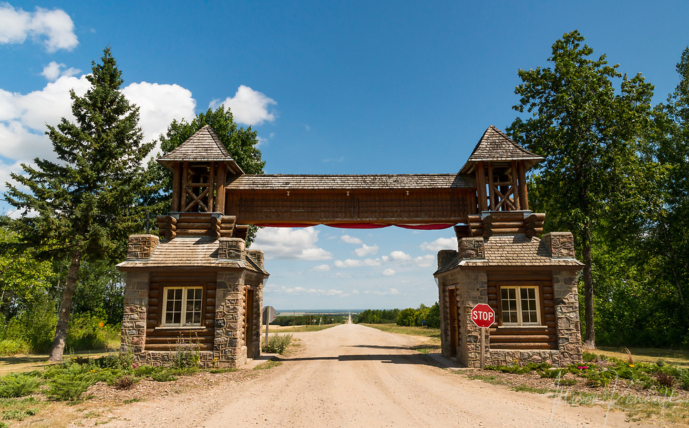 The historic East Gate at Riding Mountain National Park, looking out over the prairie farmland of Manitoba, Canada