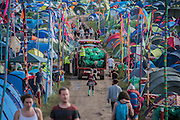 Morning rubbish collection attempts to keep on top of the nights rubbish - The 2016 Glastonbury Festival, Worthy Farm, Glastonbury.