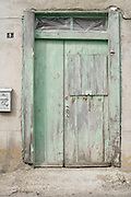 old weathered wooden door of a domestic house with peeling paint