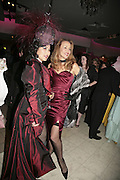 Patti Wong and Jerry Hall, Andy and Patti Wong's Chinese New Year of the Pig party. Madame Tussauds. ( Dress Burlesque, Debauched or Hollywood Black Tie. ) London. 27 January 2007.  -DO NOT ARCHIVE-© Copyright Photograph by Dafydd Jones. 248 Clapham Rd. London SW9 0PZ. Tel 0207 820 0771. www.dafjones.com.