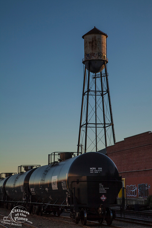 An old water tower and tanker car in Vernon, a very industrial city in the shadow of downtown Los Angeles, California, USA
