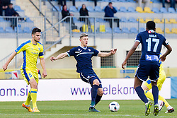 Darko Zec #5 of NK Domzale and Marko Nunic #33 of ND Gorica during football match between NK Domzale and ND Gorica in 24th Round of Prva liga Telekom Slovenije 2015/16, on March 6, 2016 in Sports park Domzale, Domzale, Slovenia. Photo by Urban Urbanc / Sportida