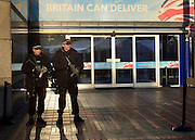 © Licensed to London News Pictures. 09/10/2012. Birmingham, UK Armed police at the entrance of The Conservative Party Conference at the ICC today 9th October 2012. Photo credit : Stephen Simpson/LNP