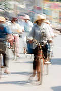 Siem Reap, Cambodia - cyclists commuting along a busy street