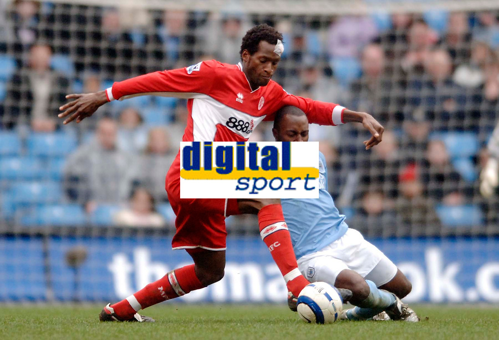 Photo: Glyn Thomas.<br />Manchester City v Middlesbrough. The Barclays Premiership. 02/04/2006.<br /> Boro's Ugo Ehiogu (L) gets to grips with Darius Vassell.