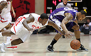 Utah guard Josh Watkins, left, and Washington forward Desmond Simmons, right, go after a loose ball during the first half of an NCAA college basketball game in Salt Lake City, Saturday, Jan. 7, 2012. (AP Photo/Colin E Braley)