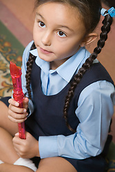 Primary school pupil learning to play the recorder in a music lesson at school,