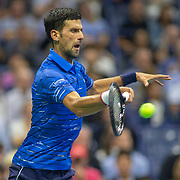2019 US Open Tennis Tournament- Day Three. Novak Djokovic of Serbia in action against Juan Ignacio Londero of Argentina in the Men's Singles Round Two match on Arthur Ashe Stadium at the 2019 US Open Tennis Tournament at the USTA Billie Jean King National Tennis Center on August 27th, 2019 in Flushing, Queens, New York City.  (Photo by Tim Clayton/Corbis via Getty Images)