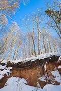 "Blue sky and trees growing on top of sandstone outcrop ""Ķiparu kaskāde"" on snowy winter day, Gauja National Park (Gaujas Nacionālais parks), Latvia Ⓒ Davis Ulands | davisulands.com"