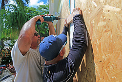 Peter Gonzalez and Jorge Abreu with Hurricane Busters Enterprises install hurricane shutters at a home in Key Largo, FL, USA, in preparation for Hurricane Irma on Wednesday, September 6, 2017. Photo by Al Diaz/Miami Herald/TNS/ABACAPRESS.COM