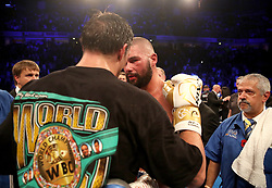 Tony Bellew (right) is consoled by Oleksandr Usyk after their WBC, WBA, IBF, WBO & Ring Magazine Cruiserweight World Championship bout at Manchester Arena.