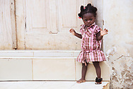 Adorable Ghanaian girl with one missing shoe