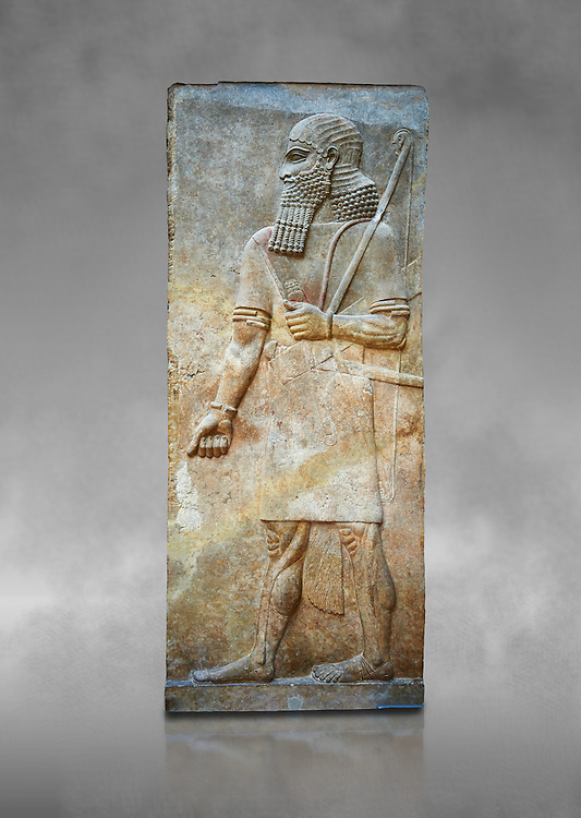 Stone relief sculptured panel of Soldier. Room 8. Inv AO 19877 from Dur Sharrukin the palace of Assyrian king Sargon II at Khorsabad, 713-706 BC.  Louvre Museum Room 4 , Paris .<br /> <br /> If you prefer to buy from our ALAMY PHOTO LIBRARY  Collection visit : https://www.alamy.com/portfolio/paul-williams-funkystock/ancient-assyria-antiquities.html  Refine search by adding background colour, place, subject, museum etc into the LOWER SEARCH WITHIN GALLERY box to <br /> <br /> Visit our ANCIENT ASSYRIAN PHOTO COLLECTIONS for more photos to download or buy as wall art prints https://funkystock.photoshelter.com/gallery-collection/Ancient-Assyrian-Art-Artefacts-Antiquities-Historic-Sites-Pictures-Images-of/C0000cjRqQyJjLag