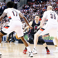 25 April 2016: Portland Trail Blazers center Chris Kaman (35), Portland Trail Blazers guard Damian Lillard (0) and Portland Trail Blazers center Ed Davis (17) defend on Los Angeles Clippers guard Austin Rivers (25) during the Portland Trail Blazers 98-84 victory over the Los Angeles Clippers, during Game Four of the Western Conference Quarterfinals of the NBA Playoffs at the Moda Center, Portland, Oregon, USA.