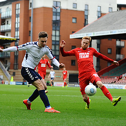 TELFORD COPYRIGHT MIKE SHERIDAN Ryan Barnett of AFC Telford (on loan from Shrewsbury Town Football Club) crosses under pressure from James Brophy of Orient during the FA Trophy semi final first leg fixture between Leyton Orient and AFC Telford United at Brisbane Road.
