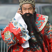 Man Talking on his Cell Phone in Chinatown, NYC during Chinese New Year's Parade