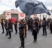 the Brixton Blackout FF force (Forever Family ) marching  from clapham common to join  Afrikan Emancipation Day celebrations in windrush sq photo by Brian Jordan