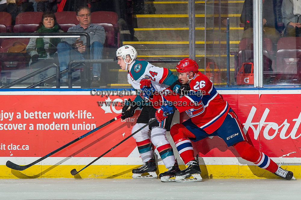 KELOWNA, CANADA - FEBRUARY 6:  Kyle Topping #24 of the Kelowna Rockets is back checked by Jack Finley #26 of the Spokane Chiefs on February 6, 2019 at Prospera Place in Kelowna, British Columbia, Canada.  (Photo by Marissa Baecker/Shoot the Breeze)