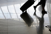 airport terminal with a person pulling a suitcase