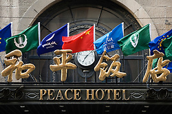Detail of entrance to historic Peace Hotel in Shanghai China
