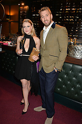 England Rugby captain CHRIS ROBSHAW and singer CAMILLA KERSLAKE at the Cirque Du Soleil's VIP performance of Kooza at The Royal Albert Hall, London on 6th January 2015.