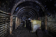 TUNNEL VISION Inside the UK's largest purpose-built WW2 bomb shelter where thousands of Brits sought refuge from Nazi attacks<br />The chilling shots were taken by urban exploration group Abandoned Scotland who hope to draw attention to some of Scotland's forgotten landmarks<br /><br />TAKE a step into the dark, rusty tunnels built in the side of a cliff in Port Glasgow, Scotland.<br /><br />But as daunting as the tunnels look, they have a fascinating history.<br />The creepy passageways were once used as a World War II air raid shelter – and would have been a safe haven to those who needed refuge from the Nazi bombings.<br /><br />The tunnels form a labyrinth like network and are thought to be one of the UK's largest such shelters – with space for up to an impressive 1,000 people.<br /><br />But what was once considered a zone of safety and security is now deserted and forgotten.<br /><br />The chilling shots were taken by urban exploration group Abandoned Scotland who hope to draw attention to some of Scotland's forgotten landmarks.<br /><br />Other pictures depict the remains of the toilets as well as the generator that would have been used to power the shelter.<br /><br />According to Abandoned Scotland , the shelter itself was built by the Birkmyre family in preparation for WW2.<br /><br />The Birkmyre family reportedly owned the nearby Gourock ropeworks – which has now been developed into flats.<br />The clan contributed considerably to the Inverclyde area as owners of the ropeworks, and the shelter was reportedly built for both the employees and their families.<br /><br />Inverclyde underwent two nights of rigorous bombing in 1941 – with May 6 and 7 referred to as the 'Greenock Blitz' .<br />Approximately 246 people died in Greenock during the two nights,  while 626 were injured – 290 of them seriously.<br /><br />A further 52 people were listed as 'missing' and presumed dead, with 74 killed in Port Glasgow, 30 of whom were in one shelter which was hit by a 2