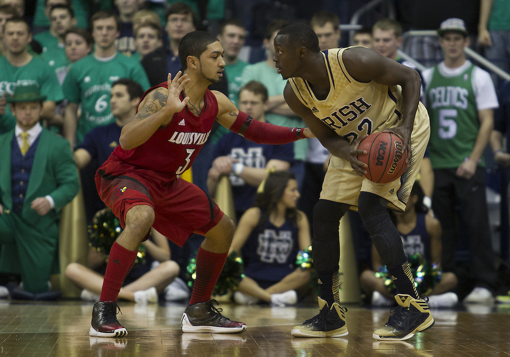 February 09, 2013:  Notre Dame guard Jerian Grant (22) with the ball as Louisville guard Peyton Siva (3) defends during NCAA Basketball game action between the Notre Dame Fighting Irish and the Louisville Cardinals at Purcell Pavilion at the Joyce Center in South Bend, Indiana.  Notre Dame defeated Louisville 104-101 in five overtimes.