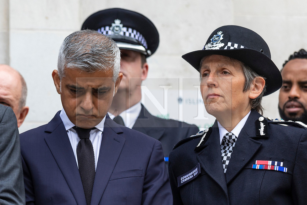 © Licensed to London News Pictures. 19/06/2018. London, UK. Mayor of London Sadiq Khan (L) and Met Police Commissioner Cressida Dick (R) join politicians, councillors, local faith and community leaders, and emergency services workers for a minute's silence on the steps of Islington Town Hall to mark the first anniversary of the Finsbury Park Attack. Photo credit: Rob Pinney/LNP
