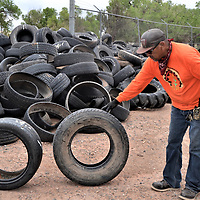 Cornfields Chapter maintenance worker Bob Yazzie explained that the larger tire on the right, which is a truck tire, is what the tire recycling project uses because its thicker and more durable. The right tire is a truck tire and the one of the left is a car tire.