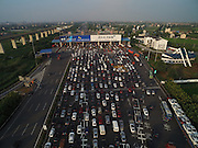 JIAXING, CHINA - SEPTEMBER 05: (CHINA OUT) <br /> Aerial view of traffic jam at a toll station on G60 Shanghai-Kunming Expressway after the 3-day holiday on September 5, 2015 in Jiaixng, Zhejiang Province of China. People driving back after the 3-day holiday for the 70th anniversary of the victory of the Chinese People\'s War of Resistance Against Japanese Aggression caused a 3-kilometer traffic jam at a toll station on G60 Shanghai-Kunming Expressway. <br /> ©Exclusivepix Media