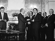 New Fianna Fáil Administration Sworn In.  (R52)..1987..10.03.1987..03.10.1987..10th March 1987..After their win in the recent general election the new Fianna Fáil government,under the leadershio of Charles Haughey, was sworn in and given their seals of offce at a ceremony in Áras an Uachtaráin today. The government received their seals from President Patrick Hillery...Photograph shows President Hillery presenting the seal of office to Bertie Ahern at the ceremony in the Arás