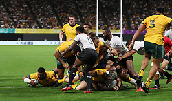 Australia's Silatolu Latu scores their third try during the 2019 Rugby World Cup Pool D match at Sapporo Dome.