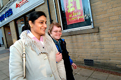 Man with learning disabilities shopping with carer; Bradford; Yorkshire UK