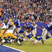 Brandon Jacobs, New York Giants, goes in for a touchdown during the New York Giants Vs Green Bay Packers, NFL American Football match at MetLife Stadium, East Rutherford, New Jersey, USA. 17th November 2013. Photo Tim Clayton