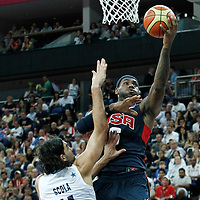 10 August 2012: USA LeBron James goes for the layup over Argentina Luis Scola during 109-80 Team USA victory over Team Argentina, during the men's basketball semi-finals, at the North Greenwich Arena, in London, Great Britain.