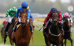 Adjutant and Jim Crowley (left) get the better of Why We Dream ridden by Sylvester De Sousa to win Division I of The Dubai Duty Free Tennis Championships Maiden Stakes Race run during Dubai Duty Free Spring Trials Saturday at Newbury Racecourse.