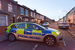 © Licensed to London News Pictures. 25/03/2016. London, UK. A police car at the cordon in Tower Hamlets Road, behind Magpie Close in Forest Gate, east London. Five people have been taken to hospital, with one man in a critical condition. Photo credit : Vickie Flores/LNP