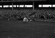 Railway Cup Final. Famed Cork hurler, Christy Ring, in full flight at the match with Leinster in Croke Park. Widely regarded as one of the greatest hurlers in the history of the game, he won eight senior All Ireland medals. <br /> 17.03.1963