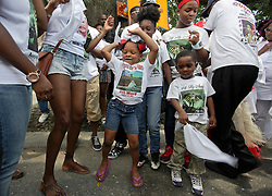 29 August 2015. Lower 9th Ward, New Orleans, Louisiana.<br /> Hurricane Katrina 10th anniversary memorials.  <br /> Dancing on the street. A 2nd line parade to celebrate those who perished in the storm. <br /> Photo credit©; Charlie Varley/varleypix.com.