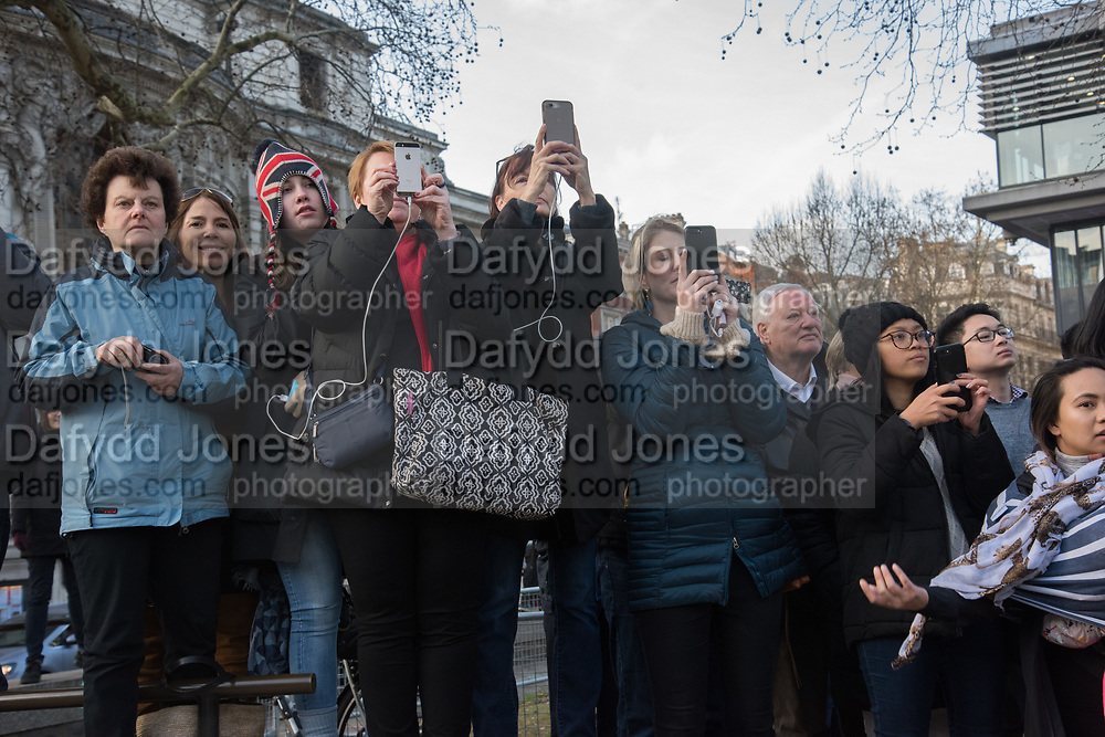 Onlookers watching the queen and members of the royal family attending the The Commonwealth Service, Westminster Abbey, London, 11 March 2019