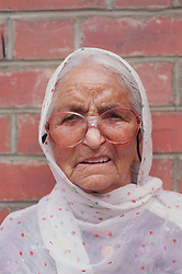 Portrait of elderly woman wearing shawl,