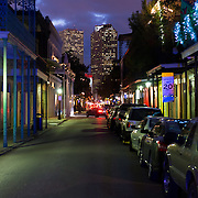 New Orleans French Quarter Street at Night with skyscraper in the background